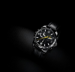 close up view of nice man's wrist watch on black background