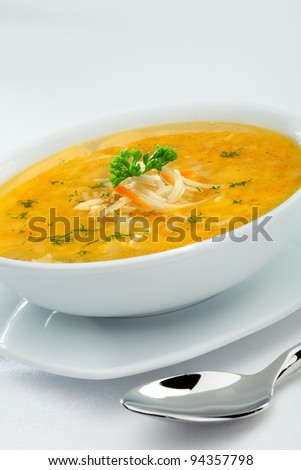 close up view of nice soup  with vegetables on white back