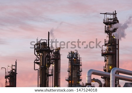 Close up view of oil refinery piping and towers
