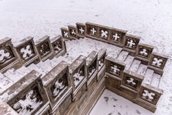 Close-up view of old ornamental castle staircase in Sychrov Castle in winter time. Czech Republic.
