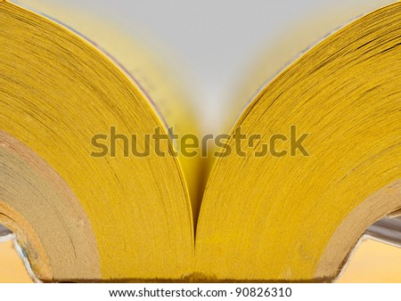 Close-up view of open yellow pages book - stock photo