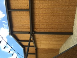 close up view of oriental strands board ceiling with steel structure