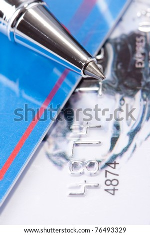 Close-up view of pen on credit cards