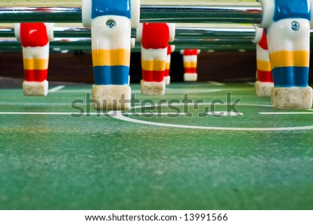 Close up view of plastic players in a football table