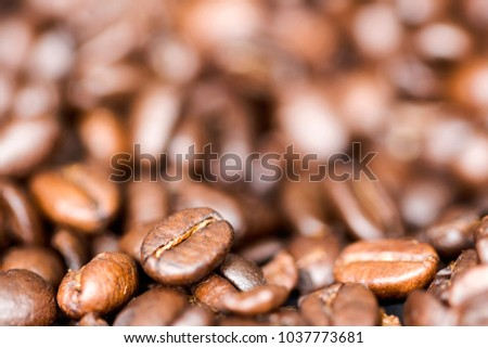close-up view of roasted coffee beans with a blurred background #1037773681