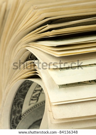 Close-up view of roll of $100 bills