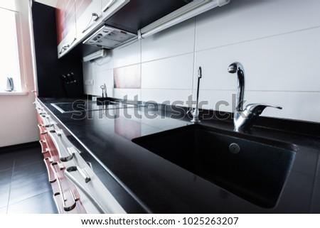 close up view of sink and faucets in kitchen #1025263207