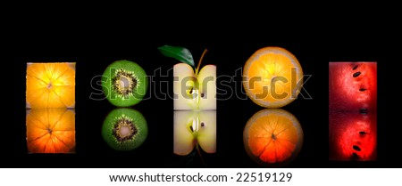 Close up view of sliced piece of fruits on black back