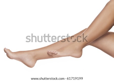 close up view of smooth womanâ??s legs on white background