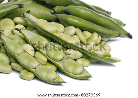 Close up view of some broad beans isolated on a white background.