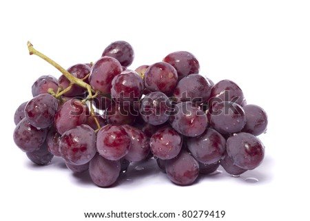 Close up view of some red wine grapes isolated on a white background.