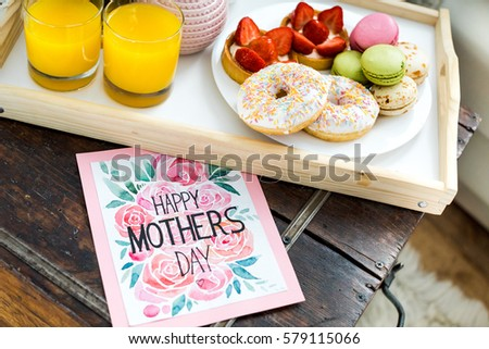 Close-up view of sweet festive breakfast and happy mothers day greeting card #579115066