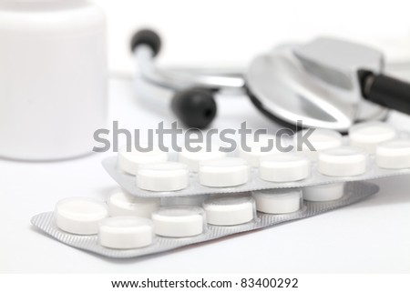 Close up view of tablets and stethoscope. Conceptual medical still-life