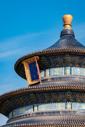 Close up view of the building in Temple of Heaven against blue sky, the landmark of Beijing, china. Chinese characters mean
