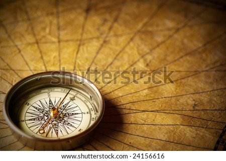 Close up view of the compass on old paper