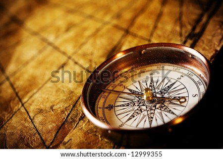 Close up view of the Compass on the old paper background