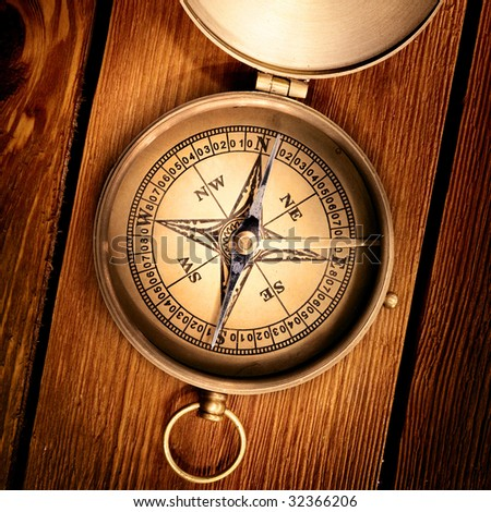 Close up view of the compass on thewood board