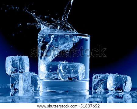 Close up view of the ice cubes splash in water on black