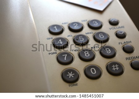 Close up view of the keypad in a dial telephone #1485451007