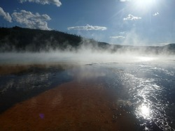 Close-up view of the microbial mats, steam and colorful runoff from the Grand Prismatic Spring in Yellowstone National Park
