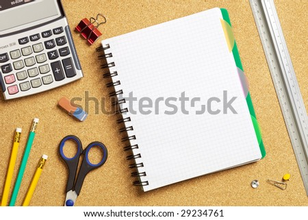 Close up view of the office tools on cork board