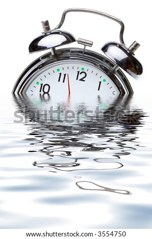 close-up view of the oldfashioned alarm clock in water