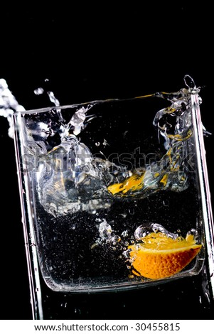 Close up view of the orange  splash in water