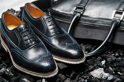 Close-up view of the pair stylish and elegant men's shoes and  bag for business meetings and business lifestyle