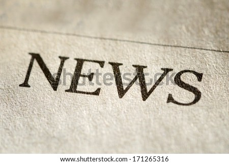 Close up view of the printed typed header for News on textured paper of a newspaper or journal