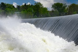 Close up view of the white water thundering and splashing from the dam in the Richelieu River near the Parc des Rapides close to Chambly, Canada