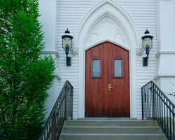 Close up view of the wooden door entrance of Historic Saint Mary's church Holliston Massachusetts usa