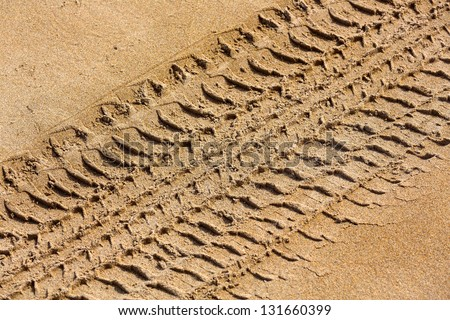Close up View of Tire Tracks Prints in Sand on a Beach