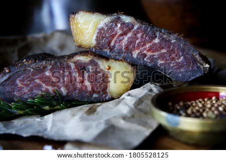 Close up view of two pieces of Traditional South African dried meat or Biltong Stock photo ©