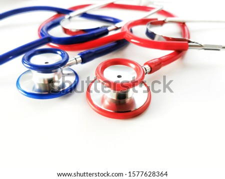 Close up view of two stethoscopes on white background. Healthcare And Medicine concept.