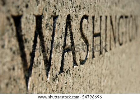 Close-up view of Washington sign on World War II memorial in Washington DC. - stock photo