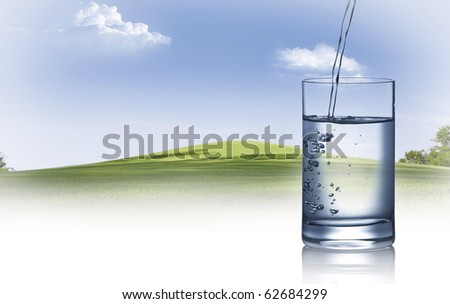 close up view of water filled glass on summer background