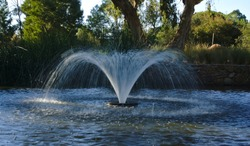 Close up view of water fountain in park