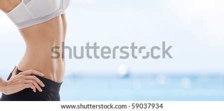 Close up view of well shaped womanâ??s body in summer environment