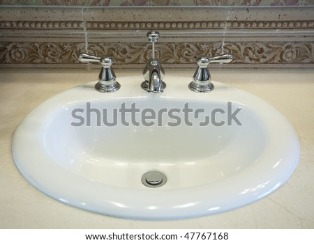 Close up view of white sink in the bathroom