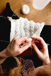 Close up view of woman hands knitting Estonias traditional Haapsalu shaw, also known as Haapsalu scarf.