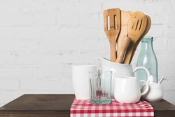 close-up view of wooden cooking utensils and cookware on table in kitchen