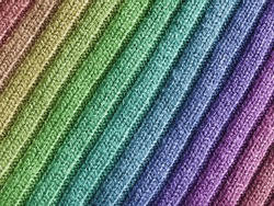 Close-up view of wool fabric pattern with rainbow coulors.