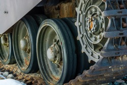 Close up view of world war tank road wheels and tracks