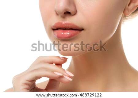 Close up view of young beautiful caucasian woman face isolated over white background. Lips contouring, SPA therapy, skincare, cosmetology and plastic surgery concept #488729122