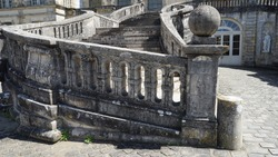 Close up view on aged grey stone staircase in Fontainebleau chateaux