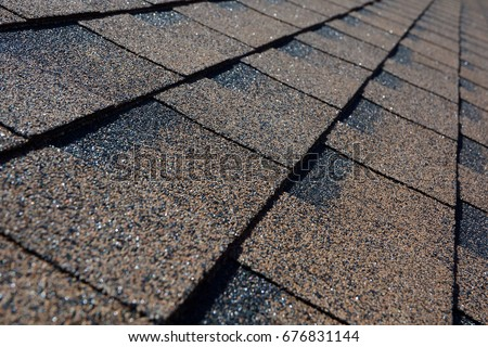 Close up view on asphalt roofing shingles background.