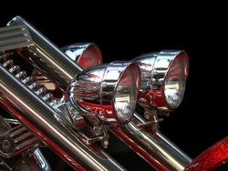 Close-up view on chrome headlights of luxury bike