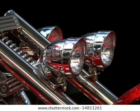 Close-up view on chrome headlights of luxury bike