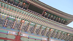 close up view on colorful roof of traditional building in korea, asian Buddhist temple ceiling ornaments architecture roofs.