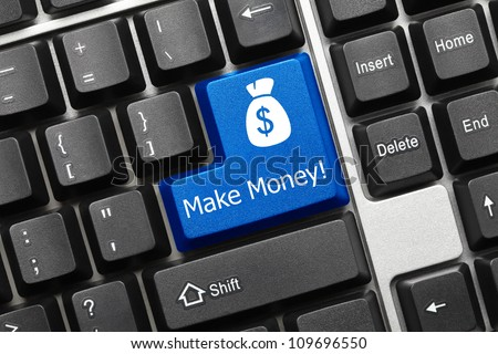 Close up view on conceptual keyboard - Make Money (blue key)